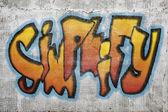 Simplify word graffiti on plaster wall — Stockfoto