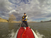 Kneeling on stand up paddleboard — Photo