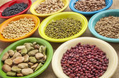 Variety of beans in bowls — Stock Photo
