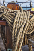 Coiled ropes on a sail ship — Stock Photo