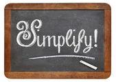 Simplify word on blackboard — Stock Photo