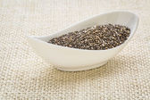 Chia seeds in a white bowl — Stock Photo