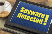 Spyware alert on digital tablet — Stock Photo