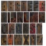 Alphabet in old dark wood type — Stock Photo #46662537