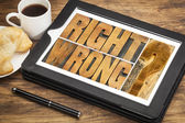 Right or wrong dilemma on tablet — Stock Photo