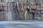 Rock cliff and whitewater river — Stock Photo