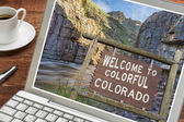 Colorado welcome sign on laptop — Stock Photo