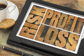 Risk, profit, loss on a tablet — Stock Photo