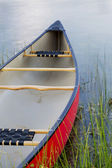 Red canoe on lake — Stock Photo