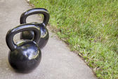 Kettlebells - backyard fitness — Stock Photo
