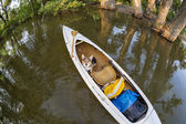 Corgi dog in canoe — Stock Photo