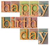 Happy birthday in wood type — Stock Photo