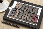 Work ethics on digital tablet — Stock Photo