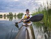 Paddling sea kayak on a lake — Stockfoto