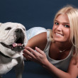 The girl with an English bulldog - Stock Photo