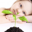 The girl and plant — Stock Photo
