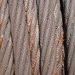 Background from a thick old steel rope in greasing - Stock Photo