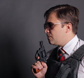 The man with a revolver — Stock Photo