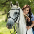Girl with horse — Stock Photo #18717723