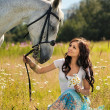 Girl with horse — Stock Photo #18717737