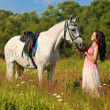 Girl with white horse — Stock Photo #18717763