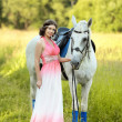 Girl with horse — Stock Photo #18717765