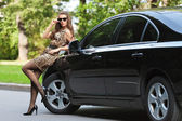 The girl in the car — Stock Photo