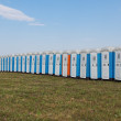 Row of cabins plastic public toilets out of doors — Stock Photo