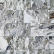 The texture of stone walls, tiled marble slabs — Stock Photo