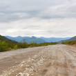 Russia, Kamchatka, desert road - Stock Photo