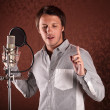 Stock Photo: Pop singer singing song in recording Studio