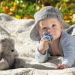 The child lies on a coverlet on the nature — Stock Photo