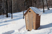 Rural lavatory in the forest in winter — Stok fotoğraf
