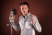 Pop singer singing a song in the recording Studio — Stock Photo