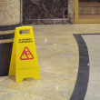 Caution wet floor - Zdjcie stockowe