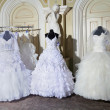 Stock Photo: Collection of wedding dresses in shop