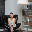 The girl in the armchair — Stock Photo