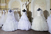 Collection of wedding dresses in the shop — Stock Photo