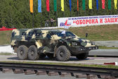 """NIZHNY TAGIL, RUSSIA- AUG 23: The russian armored car """"Bulat"""" for advanced infantry at exhibition RUSSIAN DEFENCE EXPO 2012 on August, 23, 2012 in Nizhny Tagil, Russia — Stock Photo"""