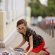 Stock Photo: Girl on the sidewalk