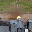Stock Photo: The firing of the ship quick-firing cannon at the landfill, test