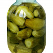 Stock Photo: Big jar with marinaded cucumbers isolated on white background
