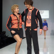 Постер, плакат: Prokhor Shalyapin and Larisa Kopenkina at fashion show