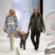 Постер, плакат: Yana Rudkovskaya and Evgeny Plushenko at fashion show