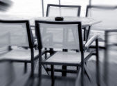 Four chairs and a table in outdoor — Stockfoto