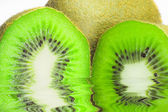 Kiwi on white background with water reflection — Stock Photo