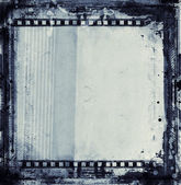 Grunge film frame with space for text or image — Stockfoto