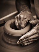 Hands working on pottery wheel — Zdjęcie stockowe