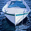 A small wooden boat anchored in the bay — Stock Photo #49205311