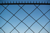 Spiked metal fence — Stock Photo